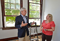 STAFF PHOTO BEN GOFF  @NWABenGoff -- 09/22/14 U.S. Rep. Steve Womack, R-Ark., talks with Julie Winn, of Aelous Property Management, while Winn leads a tour of the City Hall Lofts as part of a walking tour of new businesses in downtown Rogers for members of Main Street Rogers on Monday September 22, 2014.