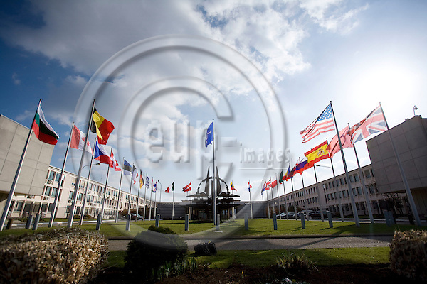 BRUSSELS - BELGIUM - 06 MARCH 2009 --  The NATO Headquarters with the big sculpture and the flags of the 26 NATO member countries outside the grass lawn in front of the main entrance.  Photo: Erik Luntang/EUP-IMAGES