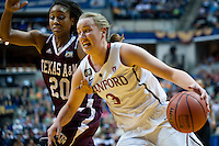 INDIANAPOLIS, IN - APRIL 3, 2011: Mikaela Ruef drives against Texas A&M at Conseco Fieldhouse during the NCAA Final Four  in Indianapolis, IN on April 1, 2011.