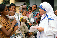 Mother Teresa with mothers and children at her Mission in Calcutta, India