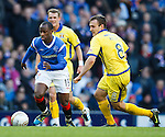 Sone Aluko gets away from Liam Kelly