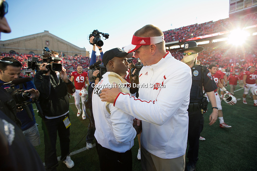 Wisconsin Badgers Head Coach Gary Andersen shakes hands with Purdue Boilermakers head coach Darrell Hazell after an NCAA Big Ten Conference football game against the Purdue Boilermakers on Saturday, September 21, 2013, in Madison, Wis. The Badgers won 41-10. (Photo by David Stluka)