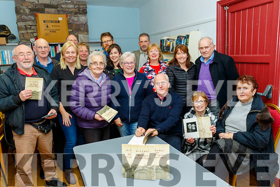 Michael Lynch, seated 3rd Rt, signs copies of the book , The Legand of Castlegregory, in which he researched and compiled and launched it last Monday night in the Castlegregory club rooms, and all proceeds go to the community council.