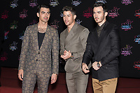 (From L) US singers Joe, Nick and Kevin Jonas also known as the Jonas Brothers pose on the red carpet as she arrives to attend the 21st NRJ Music Awards ceremony at the Palais des Festivals in Cannes, southeastern France, on November 9, 2019<br /> (G-D) Les chanteurs americains Joe, Nick et Kevin Jonas egalement connus sous le  nom de Jonas Brothers posent sur le tapis rouge lors de son arrivee a la 21e ceremonie des NRJ Music Awards au Palais des Festivals a Cannes, dans le sud-est de la France - le 9 novembre 2019.<br /> Eric Dervaux_ DALLE