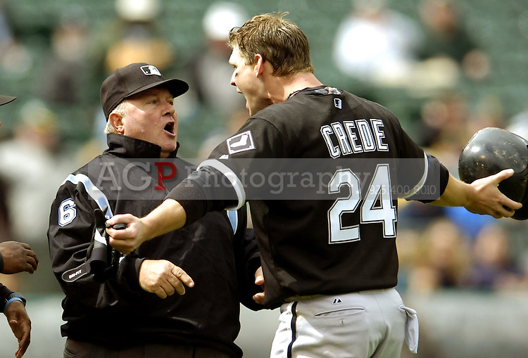 Joe Crede of the Chicago White Sox yells at umpire Bruce Froemming after being hit by a pitch in the 9th inning against the Oakland Athletics at  McAffee Coliseum Wednesday April 27, 2005. Crede was ejected from the game. The Athletics won 2-1.  (Alan Greth/Contra Costa Times)
