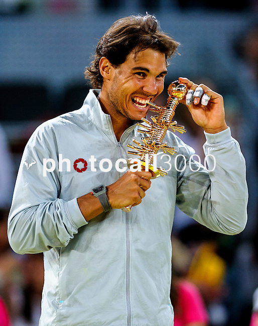 "Spanish tennis player Rafael Nadal celebrates after winning the men's singles final tennis match against Japanese tennis player Kei Nishikori at the Madrid Masters at the ""Caja Magica"" sports complex in Madrid on May 11, 2014.<br /> <br /> Photocall3000/Daniel Calleja"