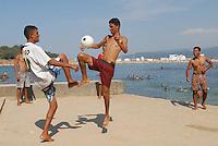 - young people play  soccer on  waterfront of Tabarka town....- giovani giocano a calcio sul lungomare della città di Tabarka