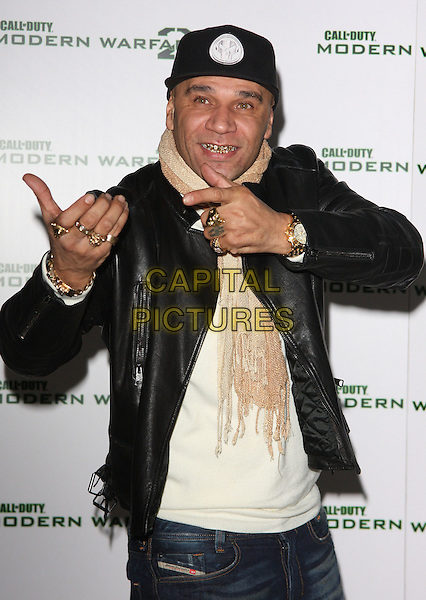"""GOLDIE (Clifford Joseph Price).""""Call Of Duty - Modern Warfare 2"""" Video Game Launch at the Vue Cinema, Leicester Square, London, England, November 9th 2009..half length cap hat hands gesture rings gold wrist watch jewellery jewelry teeth metal .CAP/ROS.©Steve Ross/Capital Pictures."""