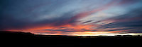 Sunset paints the sky along Highway 90 in Paradox Valley, Colorado.