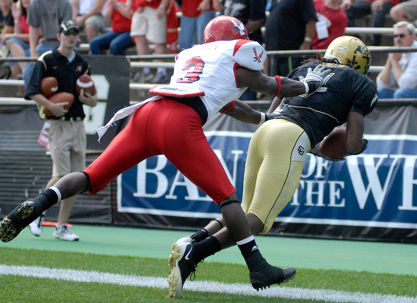 06 September 08: Colorado receiver Josh Smith drags his toes for a touchdown catch while Eastern Washington cornerback Ryan kelley tries to force him out of bounds. The Colorado Buffaloes defeated the Eastern Washington Eagles 31-24 at Folsom Field in Boulder, Colorado. FOR EDITORIAL USE ONLY