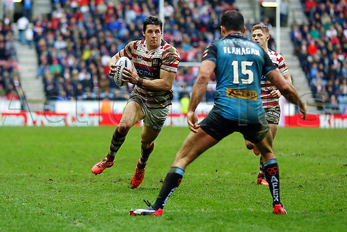 03.04.2015.  Wigan, England.  Super League Rugby. Wigan Warriors versus St Helens. Joel Tomkins of Wigan Warriors runs at Mark Flanagan of St Helens