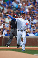 Chicago Cubs third baseman Kris Bryant (17) throws to first during a game against the Milwaukee Brewers on August 13, 2015 at Wrigley Field in Chicago, Illinois.  Chicago defeated Milwaukee 9-2.  (Mike Janes/Four Seam Images)