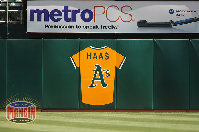 OAKLAND, CA - July 4:  A tribute to former Oakland Athletics owner Walter Haas adorns the wall in right field during the game against the Toronto Blue Jays at the McAfee Coliseum in Oakland, California on July 4, 2007.  The Blue Jays defeated the Athletics 10-3.  Photo by Brad Mangin