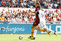 Roma's Edin Dzeko, left, is chased by Chievo Verona's Mattia Bani during the Italian Serie A football match between Roma and Chievo Verona at Rome's Olympic stadium, September 16, 2018.<br /> UPDATE IMAGES PRESS/Riccardo De Luca