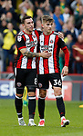 Nathan Thomas and David Brooks of Sheffield Utd applaud the fans during the Championship match at Bramall Lane Stadium, Sheffield. Picture date 16th September 2017. Picture credit should read: Simon Bellis/Sportimage