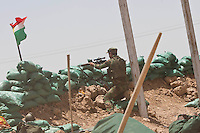KIRKUK, KURDISTAN. 21.06.14 A sniper belonging to the Kurdish special forces aims toward ISIS positions on the front lines between Kurdish forces and ISIS militants in Basheer, southern Kirkuk.
