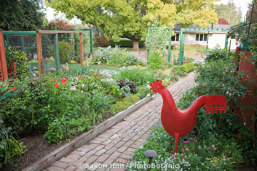 Brick path leading in from street through ornamental vegetable beds in Rosalind Creasy front yard garden