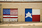 US and Texas flags painted on large doors in Littlefield, Tex.