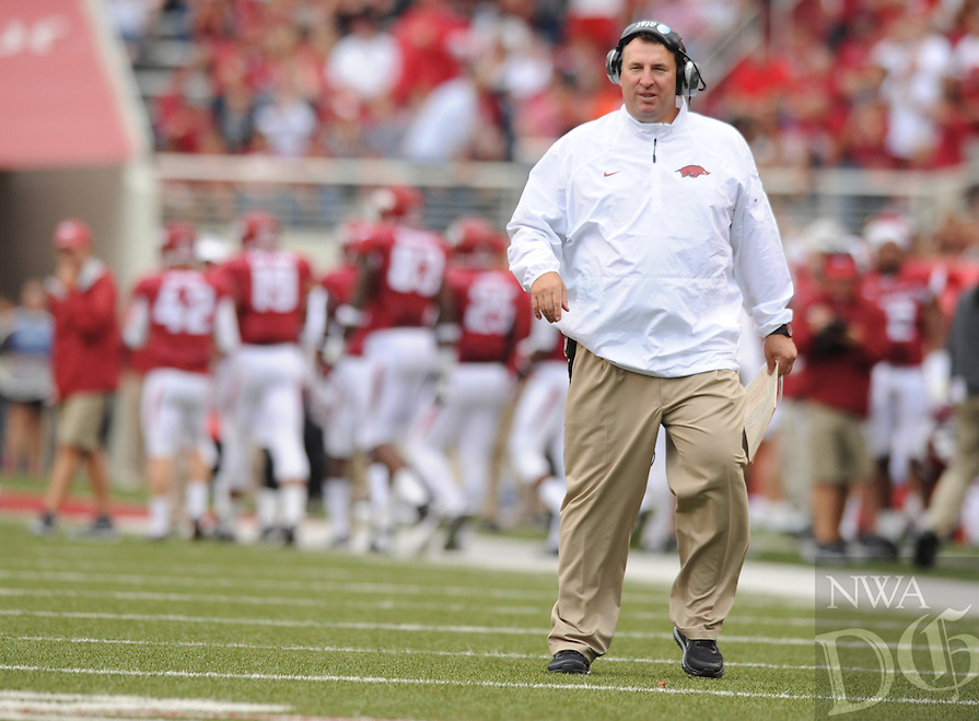 NWA Media/ANDY SHUPE - Arkansas coach Bret Bielema speaks to his players against Nicholls during the second quarter Saturday, Sept. 6, 2014, at Razorback Stadium in Fayetteville