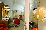 Barber Giovanni Porcu (74) posing in his shop in via Lamarmora, Sassari