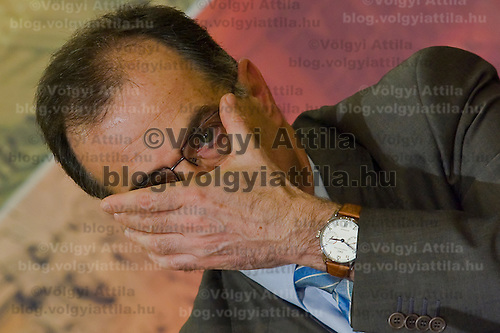Andras Simor adjusts his glasses during a press conference held in the National Bank of Hungary.