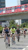 04 AUG 2007 - LONDON, UK - Age group competitors cycle under the Docklands Light Railway - London Triathlon. (PHOTO (C) NIGEL FARROW)