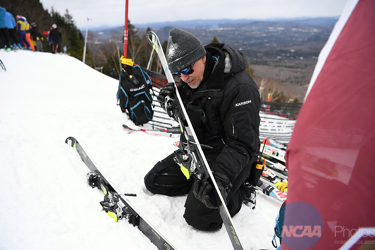 FRANCONIA, NH - MARCH 10:   A Denver coach checks ski preparation at the start area of the Men's Slalom event at the Division I Men's and Women's Skiing Championships held at Cannon Mountain on March 10, 2017 in Franconia, New Hampshire. (Photo by Gil Talbot/NCAA Photos via Getty Images)