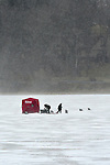 Ice fishermen in a snow squall on Rose Valley Lake. Lycoming County, PA.