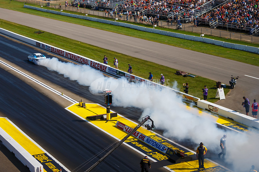 Aug 19, 2017; Brainerd, MN, USA; NHRA pro stock driver Shane Gray does a burnout during qualifying for the Lucas Oil Nationals at Brainerd International Raceway. Mandatory Credit: Mark J. Rebilas-USA TODAY Sports