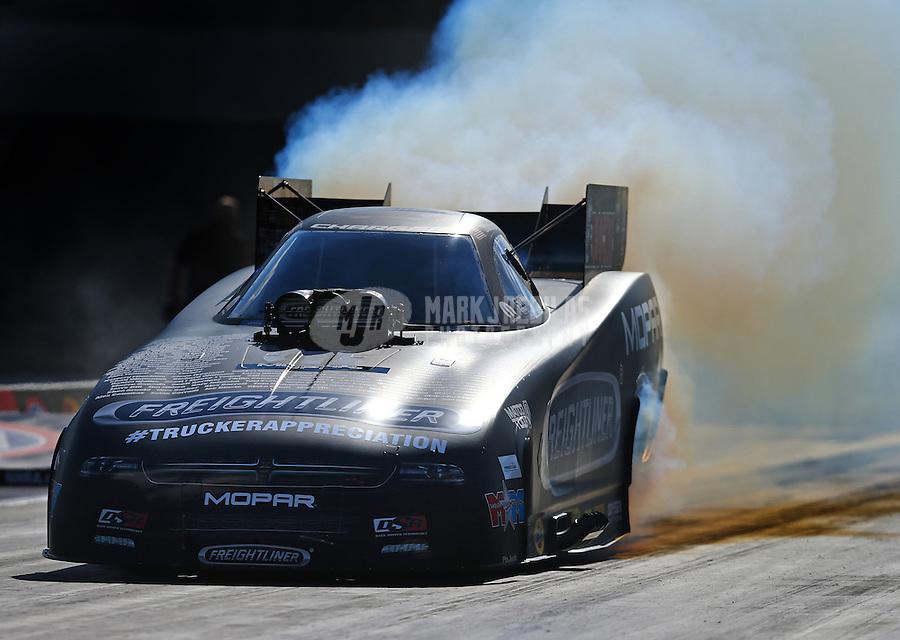 Sep 18, 2015; Concord, NC, USA; NHRA funny car driver Matt Hagan during qualifying for the Carolina Nationals at zMax Dragway. Mandatory Credit: Mark J. Rebilas-USA TODAY Sports
