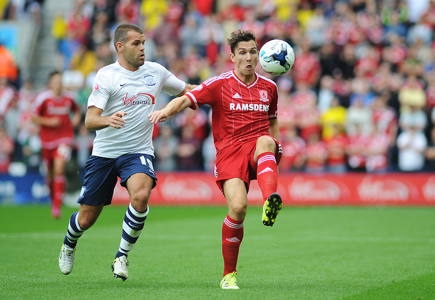 Middlesbrough's Stewart Downing under pressure from Preston North End's John Welsh<br /> <br /> Photographer Kevin Barnes/CameraSport<br /> <br /> Football - The Football League Sky Bet Championship - Preston North End v Middlesbrough -  Sunday 9th August 2015 - Deepdale - Preston<br /> <br /> &copy; CameraSport - 43 Linden Ave. Countesthorpe. Leicester. England. LE8 5PG - Tel: +44 (0) 116 277 4147 - admin@camerasport.com - www.camerasport.com
