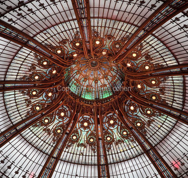 Dome of the department store Galeries Lafayette, opened 1912, on Boulevard Haussmann, 9th arrondissement, Paris, France. The shop was designed by Georges Chedanne and his pupil Ferdinand Chanut, with a huge glass and steel dome, art nouveau staircases and 3 levels of balconies. Picture by Manuel Cohen