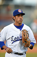 Chattanooga Lookouts outfielder Brian Cavazos-Galvez (35) jogs to the dugout during a game against the Birmingham Barons on April 24, 2014 at AT&T Field in Chattanooga, Tennessee.  Chattanooga defeated Birmingham 5-4.  (Mike Janes/Four Seam Images)