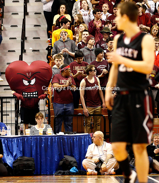 Uncasville, CT- 22 March 2015-032215CM48-  Valley Regional's Nash Eppard looks back court as the Sacred Heart mascot watches on during the Class S state championship game at Mohegan Sun Arena in Uncasville on Sunday.  The Hearts would win their second straight title, defeating Valley, 71-46. Christopher Massa Republican-American