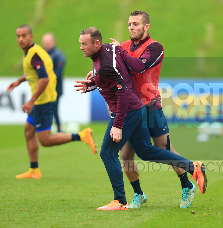 Wayne Rooney and Jack Wilshere of England collide - England Training & Press Conference - UEFA Euro 2016 Qualifying - St George's Park - Burton-upon-Trent - 11/11/2014 Pic Philip Oldham/Sportimage