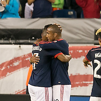 Foxborough, Massachusetts - September 5, 2015: In a Major League Soccer (MLS) match, the New England Revolution (blue/white) defeated Orlando City SC (white), 3-0, at Gillette Stadium. <br /> Juan Agudelo celebrates his goal and assist by Teal Bunbury.
