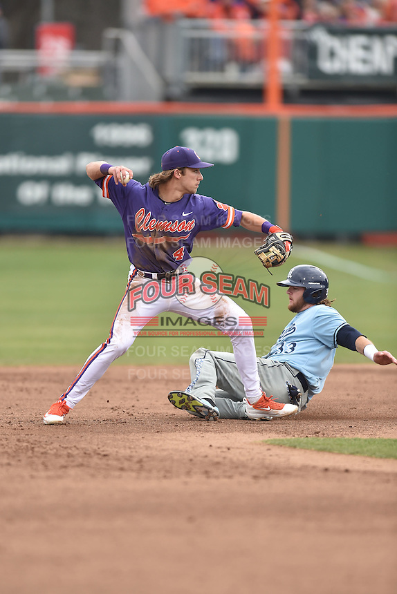 Clemson Tigers shortstop Eli White (4) makes the turn turn on a double play over a hard sliding Kevin Stypulkowski (33) during a game against the Maine Black Bears at Doug Kingsmore Stadium on February 20, 2016 in Clemson, South Carolina. The Tigers defeated the Black Bears 9-4. (Tony Farlow/Four Seam Images)