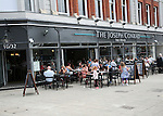 People sitting outside The Joseph Conrad Wetherspoons pub, Lowestoft, Suffolk, England