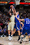 Dinos Mitoglou (44) of the Wake Forest Demon Deacons has his shot blocked by Giacomo Zilli (21) of the UNC Asheville Bulldogs during first half action at the LJVM Coliseum on November 14, 2014 in Winston-Salem, North Carolina.  The Demon Deacons defeated the Bulldogs 80-69  (Brian Westerholt/Sports On Film)