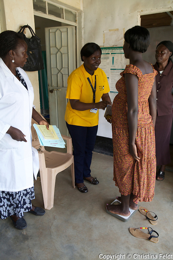 UNFPA South Sudan supports human capacity building in the health sector. UNV checking the patient's weight at Muniki health centre in the maternity unit. She assists women during their pregnancy.