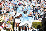 24 November 2012: UNC's Quinshad David (14) celebrates his touchdown with Jonathan Cooper (64) and James Hurst (73). The University of North Carolina Tar Heels played the University of Maryland Terrapins at Kenan Memorial Stadium in Chapel Hill, North Carolina in a 2012 NCAA Division I Football game. UNC won 45-38.