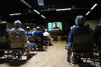 El Sueno Existe Festival<br /> Machynlleth<br /> Wales<br /> Our Future, Our Planet Our Dream<br /> Members audience watching a video message from the imprisoned Columbian trade union leader Huber Ballesteros trade union. UNITE the union are leading a UK campaign for Huber's release.