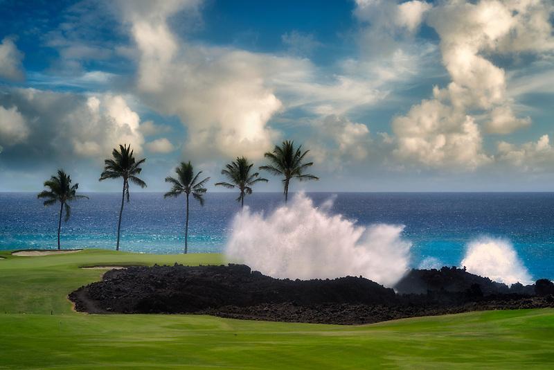 Crashing waves, palm trees and golf course. Hilton Waikoloa Beach Golf Resort. Hawaii, The Big Island