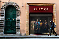 A woman walks past Gucci shop in Rome during Italy's lockdown due to Covid-19 pandemic. <br /> On May 4th will start the phase 2 of the measures against pandemic, adopted by Italian government, that will allow some construction and factory workers to go back to work . <br /> Rome 30/04/2020 <br /> Photo Andrea Staccioli Insidefoto