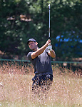 Tony Romo hits a shot out of the rough on the 10th hole during the American Century Championship at Edgewood Tahoe Golf Course in Stateline, Nevada, Saturday, July 14, 2018.
