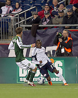 New England Revolution forward Sainey Nyassi (17) on the wing as Portland Timbers defender Eric Brunner (5) defends. In a Major League Soccer (MLS) match, the New England Revolution tied the Portland Timbers, 1-1, at Gillette Stadium on April 2, 2011.