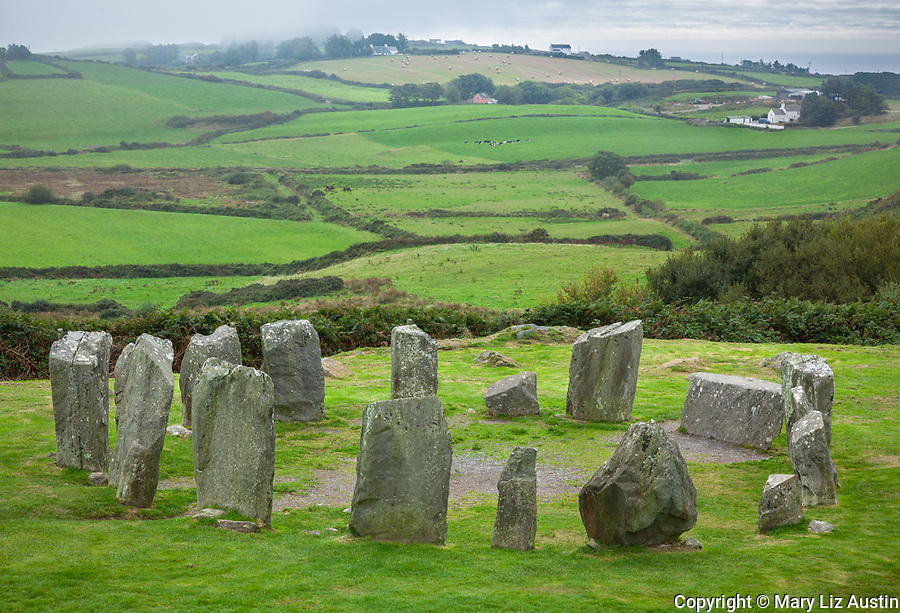 County Cork, Irelend: Standing stones of the Drombeg stone circle (akd Druid's Altar) dating from 1100-800 BC among the patchwork hillside near Glandore