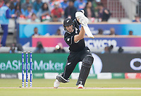 Martin Guptill (New Zealand) drives into the covers during India vs New Zealand, ICC World Cup Semi-Final Cricket at Old Trafford on 9th July 2019