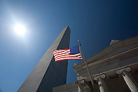 The obelisk and exhibit lodge and American Flag of the Bunker Hill Monument in Charlestown, Massachusetts.