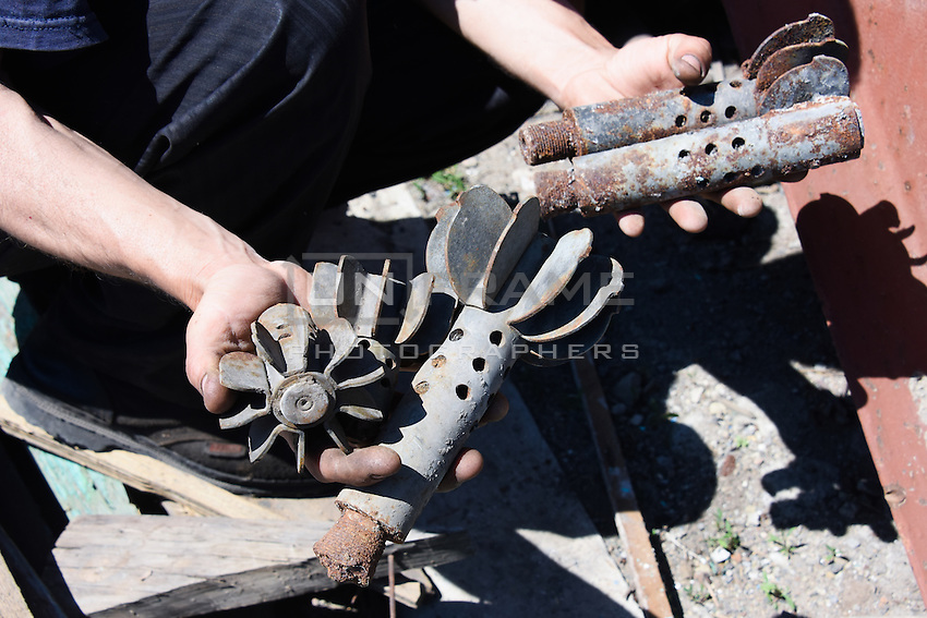 Tailpieces  of 82-BM-37 calibre mortar shell  after shelling near Donetsk International Airport, Eastern Ukraine, 20 May, 2015